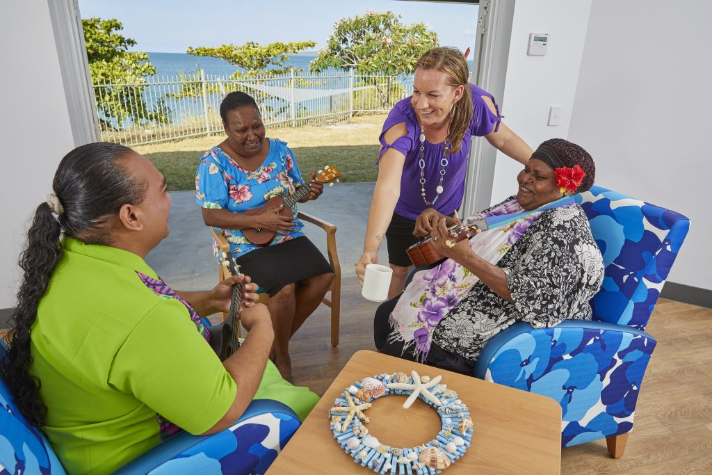 photo of staff singing and having coffee at the star of the sea nursing home on thursday island.